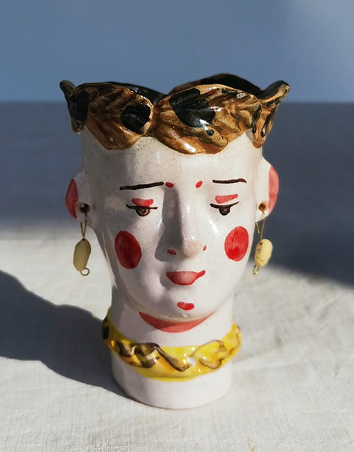 """The Exvotos"". Cabeza recipiente de cerámica"