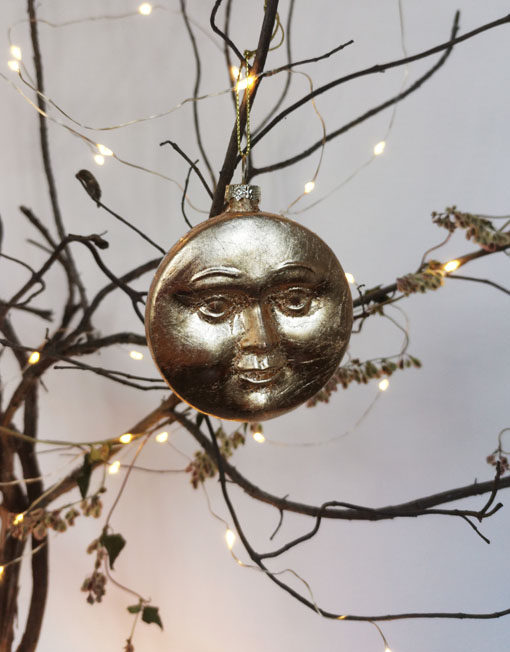 Eclipse. Sun and Moon. Christmas ornament